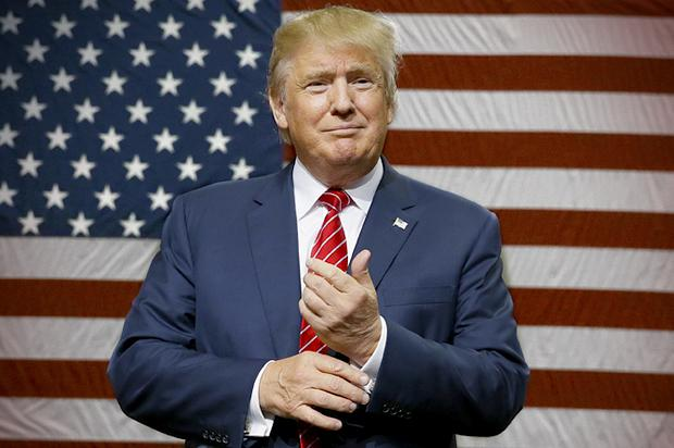 Republican presidential candidate Donald Trump speaks to supporters as he takes the stage for a campaign event in Dallas, Monday, Sept. 14, 2015. (AP Photo/LM Otero)