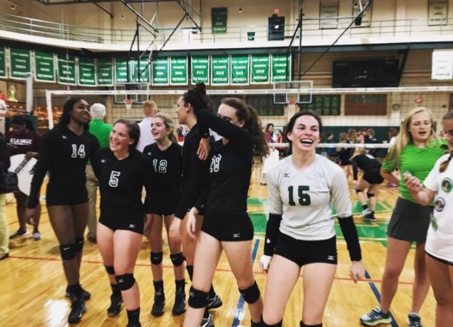 Senior volleyball players Aaliyah Burras, Julia Nelson, Olivia Brown, Cameryn Jones, Lady Reynolds, and Adele Reynoir celebrate their win against rival Sacred Heart.