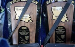 Safety First! Newman Swim Team secures the 99th and 100th state championships