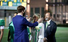 Newman Senior Class President Will Gottsegen crowns the 2020 Homecoming Queen Lucy Lynch